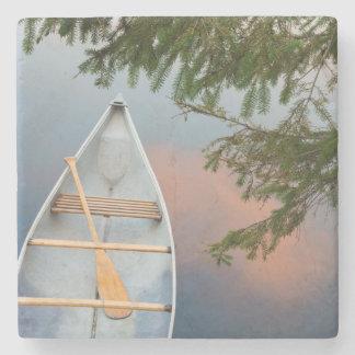 Canoe on lake at sunset, Canada Stone Coaster