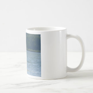 Canoe on the water coffee mug