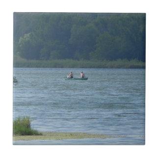 Canoe on the water tile
