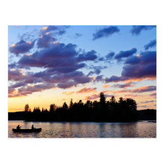 Canoeing at sunset postcard