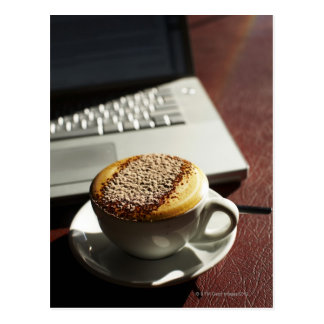 Cappuccino in front of laptop postcard