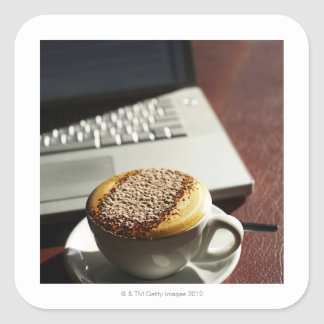 Cappuccino in front of laptop square sticker
