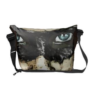 Capuchino man in brown messenger bag