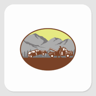 Car being towed Away Mountains Oval Woodcut Square Sticker