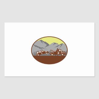 Car being towed Away Mountains Oval Woodcut Sticker