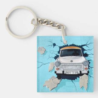 Car crosses a wall keychain