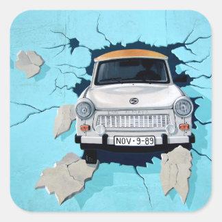 Car crosses a wall square sticker