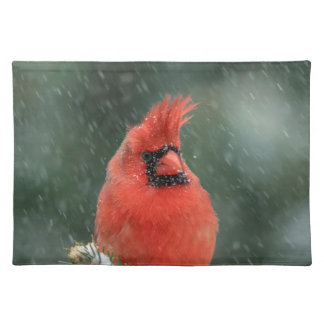 Cardinal in a pine tree during a snow storm placemat