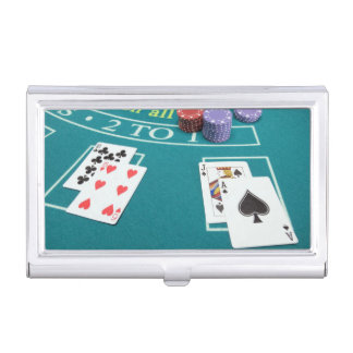Cards and chips on betting table business card case