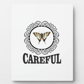 careful circle plaque