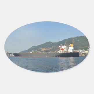 Cargo Ship Entering Gibraltar Oval Sticker