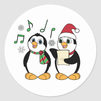 Caroling Penguins in the Snow Sticker