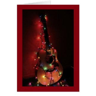 Carte de Noël de joueur de guitare