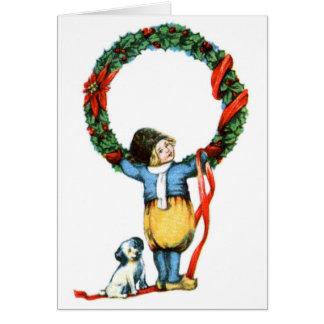 Carte de Noël démodée vintage de garçon et de chie