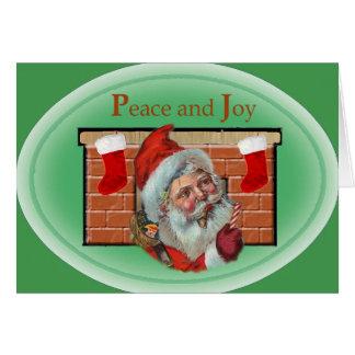 Carte démodée de Père Noël de paix et de joie