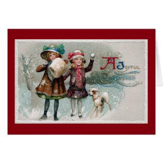 Carte Filles et chien démodés de Noël dans la neige
