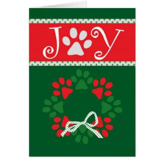 Carte mignonne d'empreintes de pattes de Noël
