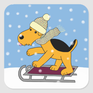 Cartoon Airedale Terrier Dog on Sled Sticker