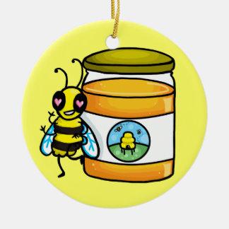 Cartoon bee leaning on honey jar ceramic ornament