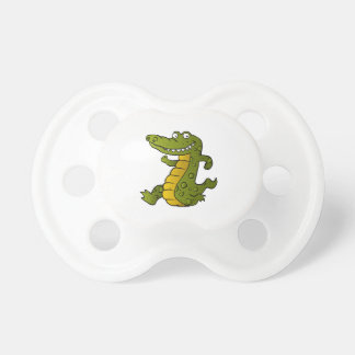 Cartoon crocodile. pacifiers