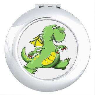 Cartoon green dragon walking on his back feet travel mirrors
