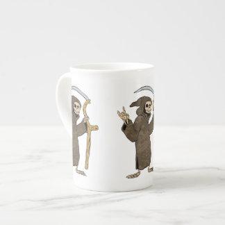 cartoon grim reaper. tea cup