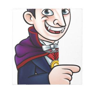 Cartoon Halloween Vampire Pointing at Sign Notepad