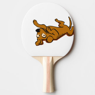 Cartoon happy dog is lying down ping pong paddle