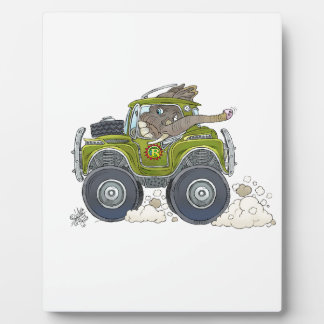 Cartoon illustration of a Elephant driving a jeep. Plaque