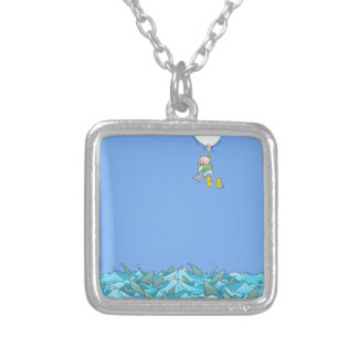 Cartoon illustration of a man hanging over sharks. silver plated necklace