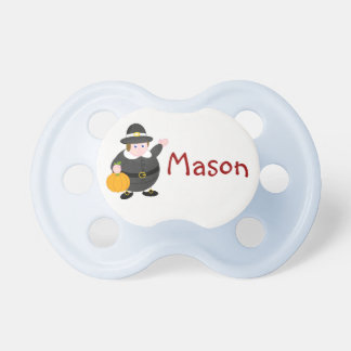 Cartoon of a Thanksgiving Pilgrim Father & pumpkin Pacifier