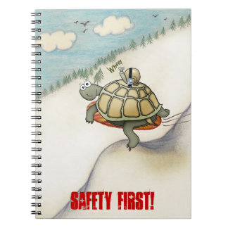 cartoon of tortoise and snail with seat belt spiral note book
