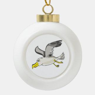 Cartoon seagull flying over head ceramic ball christmas ornament