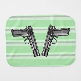 Cartoon style illustration of two handguns baby burp cloths