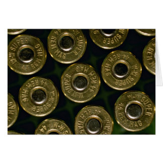 Cartridges, .44 magnums in carrier, detail of cap card