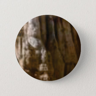 carved muscles in rock 2 inch round button