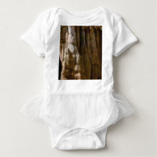 carved muscles in rock baby bodysuit