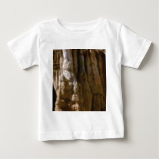 carved muscles in rock baby T-Shirt
