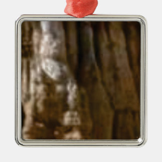carved muscles in rock metal ornament