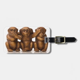 Carving of three wooden monkeys bag tag