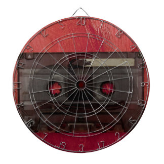 Cassette tape music vintage red dartboard with darts