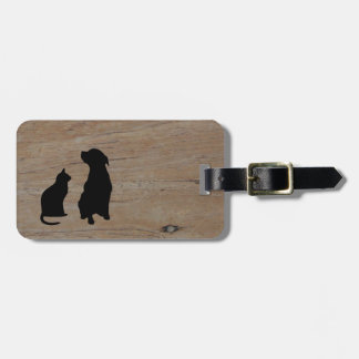 Cat and dog illustration silhouettes on wood luggage tag