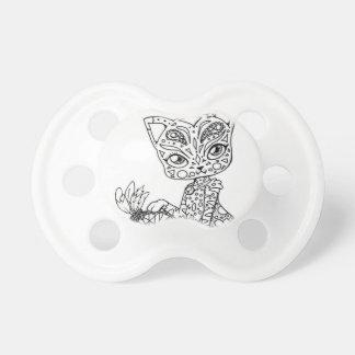 Cat bites pacifier