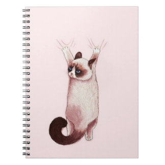 Cat hanging on by claws spiral notebook