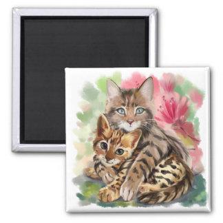 Cat hugs kitten magnet