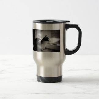 Cat looking outside travel mug