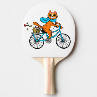 Cat riding a bicycle ping pong paddle