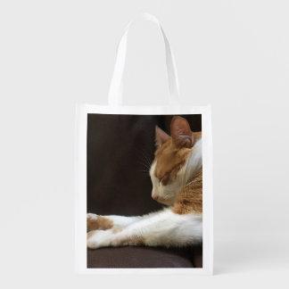 Cat sleeping on sofa reusable grocery bag