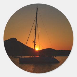 Catamaran at sunset Ibiza.JPG Round Sticker