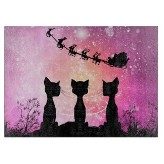 Cats looks to the sky to Santa Claus Cutting Board